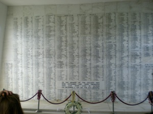 Wall inside the Arizona Memorial listing all the names of the fallen from attack on Pearh Harbor carved in white marble.