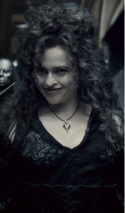 Bellatrix Lestrange, as portrayed by Helena Bonham Carter, a pale woman with a mop of dark, thick curly hair lightly tinged with strands of grey, smirking devilishly in a black dress with white embroidery, pointing her wand at her own face.