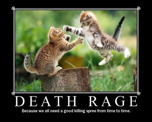 "Two tabby-ish kittens fighting on a tree stump. Text reads ""Death Rage. [next line] Because we all need a good killing spree from time to time."""