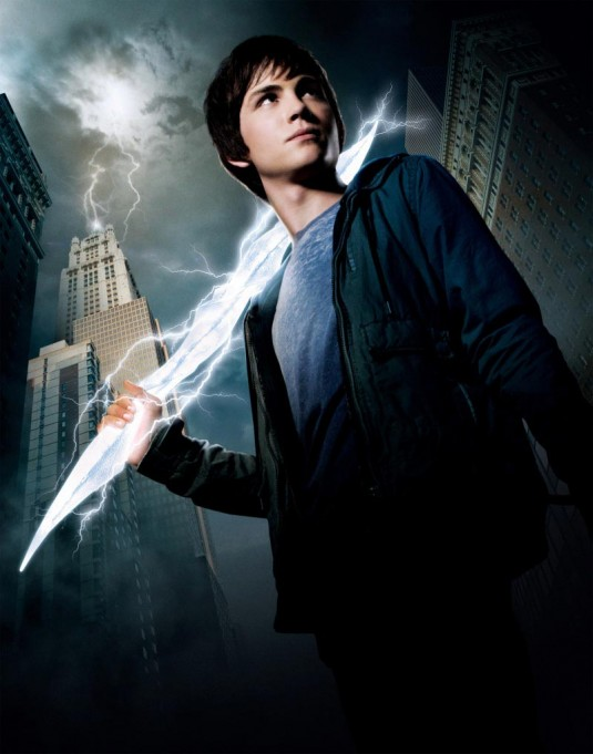 Percy Jackson, a pale young man wearing a grey shirt and jacket, weilds a lightening bolt with skyscrapers in the background.