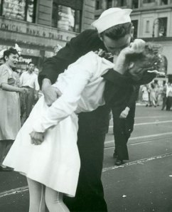 Iconic photo form the end of WWII, a sailor in a dress blue uniform kisses a nursh in a white uniform in New York's Time Square