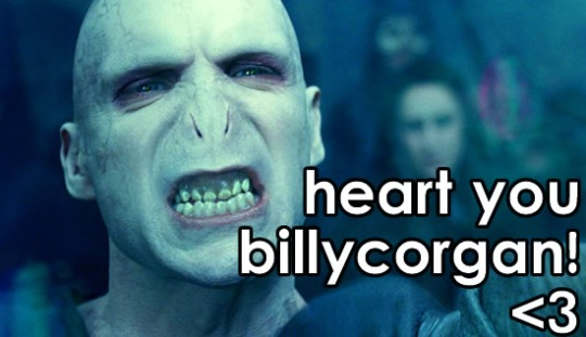 "Lord Voldemort as portrayed by Ralph Fiennes, gritting his teeth together and squinting his eyes. Text reads ""heart you billy corgan!"" with a ""<3"" to mean a heart."